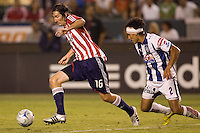 Chivas midfielder Sacha Kljestan (16) moves around Pachuca defender Leobardo Lopez (2). Pachuca CF defeated the Chivas USA 2-1 during the 1st round of the 2008 SuperLiga at Home Depot Center stadium, in Carson, California on Sunday, July 13, 2008.