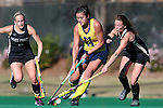 14 November 2015: Michigan's Katie Trombetta (14) and Wake Forest's Kali Vicars (right). The Wake Forest University Demon Deacons played the University of Michigan Wolverines at Francis E. Henry Stadium in Chapel Hill, North Carolina in a 2015 NCAA Division I Field Hockey Tournament First Round match. Michigan won the game 2-1.
