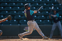 Gavin Collins (9) of the Lynchburg Hillcats follows through on his swing against the Winston-Salem Rayados at BB&T Ballpark on June 23, 2019 in Winston-Salem, North Carolina. The Hillcats defeated the Rayados 12-9 in 11 innings. (Brian Westerholt/Four Seam Images)