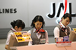 Apr. 12, 2010 - Tokyo, Japan - Ground staff employees are pictured at Tokyo's Haneda airport on April 12, 2010. Japan Airlines (JAL) and All Nippon Airways uniforms are now incredibly popular among fans with a uniform fetish and can command exorbitant prices on on-line auction sites.