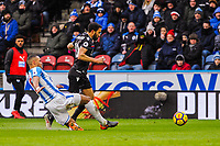 Huddersfield Town's defender Mathias Jorgensen (25)  chops down Crystal Palace's midfielder Andros Townsend (10) for a penalty during the EPL - Premier League match between Huddersfield Town and Crystal Palace at the John Smith's Stadium, Huddersfield, England on 17 March 2018. Photo by Stephen Buckley / PRiME Media Images.