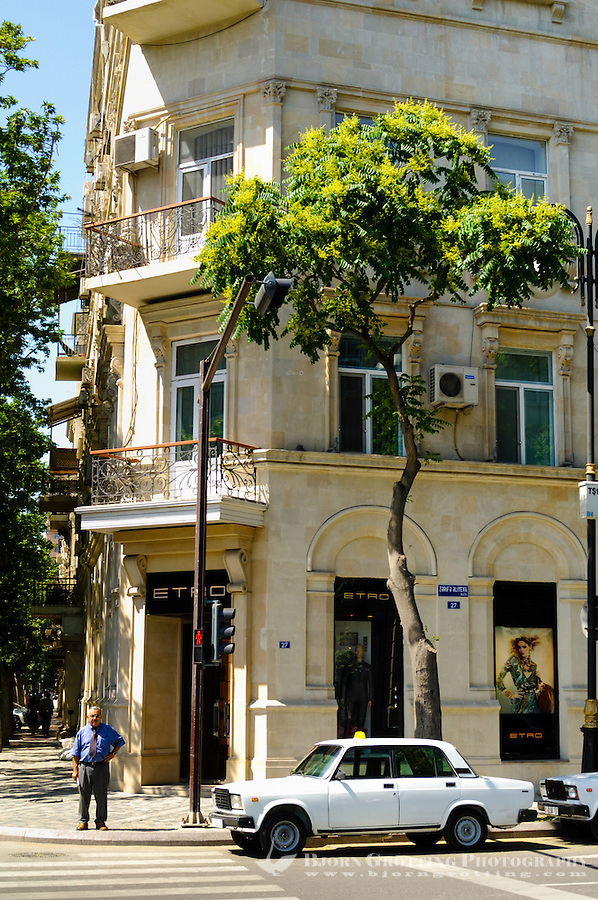 Azerbaijan, Baku. Baku is the capital, the largest city, and the largest port of Azerbaijan and entire Caucasus. Street view with a Lada taxi.
