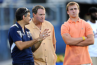 12 August 2011:  Former Cleveland Browns, University of Miami Hurricanes and University of North Carolina Tar Heels Head Coach Butch Davis (center) speaks with FIU Athletic Director Pete Garcia (left) (also pictured, Davis' son, Drew (right)) during a scrimmage held as part of the FIU 2011 Panther Preview at University Park Stadium in Miami, Florida.