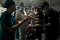MEDELLIN, COLOMBIA - MAY 12: Nurses receive gifts during the International Nurses Day tribute, at the Sagrado Corazón Clinic in Medellín, Colombia, on May 12, 2020. The coronavirus pandemic has claimed more than 290,000 lives around the world, according to an account from official sources. (Photo by Fredy Builes / VIEWpress via Getty Images)