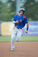 Jared Young (16) of the South Bend Cubs hustles towards third base against the West Michigan Whitecaps at Fifth Third Ballpark on June 10, 2018 in Comstock Park, Michigan. The Cubs defeated the Whitecaps 5-4.  (Brian Westerholt/Four Seam Images)