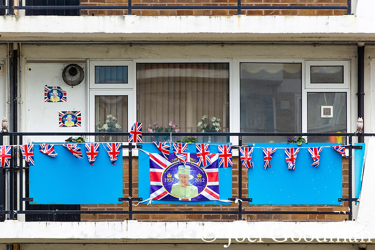 © Joel Goodman - 07973 332324 . 01/06/2012. Salford , UK. Flags suspended from balconies outside flats at Canon Green Court as people prepare to mark the Queen's Diamond Jubilee. Photo credit : Joel Goodman