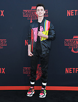 "28 June 2019 - Santa Monica, California - Noah Schnapp. ""Stranger Things 3"" Los Angeles Premiere held at Santa Monica High School. Photo Credit: Birdie Thompson/AdMedia"