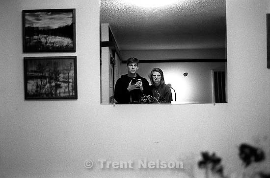 Trent Nelson and Laura Nelson in mirror with camera.<br />