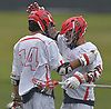 Dillon Studdert #6 of Hills East, right congratulates teammate Drew Martin #14 after he scored a goal in the first quarter of the Suffolk County varsity boys lacrosse Division I (Class A) quarterfinals against Commack at Half Hollow Hills High School East on Friday, May 19, 2017. Hills East won by a score of 11-9.