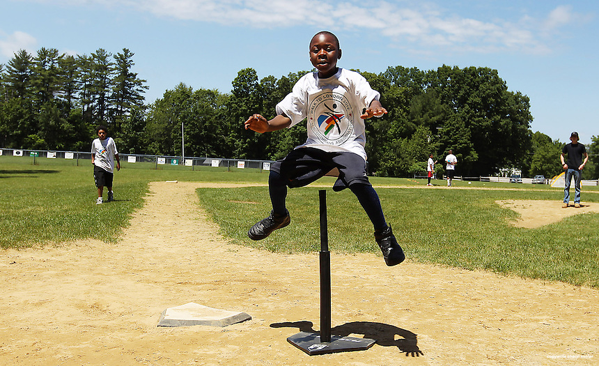 Ivan Nyantenji, 9, of Nashua, shows off his vertical leap prowess in Stratham, N.H., Sunday, June 17, 2012, while at an event to foster Olympian spirit in support of the Summer Olympic Games in London.  (Portsmouth Herald Photo Cheryl Senter)