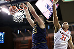 CHARLOTTESVILLE, VA - MARCH 03: Notre Dame's Martinas Geben (LTU) (23) dunked past Virginia's Isaiah Wilkins (21). The University of Virginia Cavaliers hosted the University of Notre Dame Fighting Irish on March 3, 2018 at John Paul Jones Arena in Charlottesville, VA in a Division I men's college basketball game. Virginia won the game 62-57.