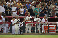 PHOENIX - JULY 12:  Tim Flannery, Matt Cain and Tim Lincecum of the National League pause during the 7th inning stetch against the American League during the 2011 MLB All-Star Game at Chase Field on July 12, 2011 in Phoenix, Arizona. Photo by Brad Mangin