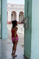girl using public phone in Havana , Cuba