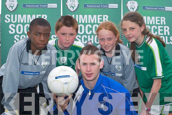 FAI: Launching the FAI Summer Soccer Skills Schools in Killarney Celtics pitch on Tuesday were, l-r: Nzau Kimfuta, Bob Hennessy (National Irish Bank), Alan Brosnan, Peter McCarthy (Limerick 37), Chloe ODoherty, Mike and April Foley..
