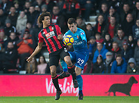 Nathan Ake of AFC Bournemouth & Granit Xhaka of Arsenal during the Premier League match between Bournemouth and Arsenal at the Goldsands Stadium, Bournemouth, England on 14 January 2018. Photo by Andy Rowland.