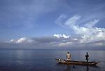 Men fishing on Lake Kivu, a volcanic lake on the Rwandan border with the Central Democratic Republic of Congo (CAR)