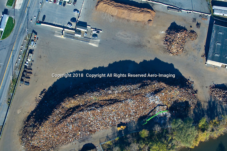 Aerial views of the Delaware Valley area. Aerial view of Scrap Metal Exporting Facility at the Port of Wilmington, Delaware.<br /> Steel is an important import and export commodity for the Port of Wilmington, a member of the AIIS  (American Institute for International Steel).  As the first inbound deep water port on the Delaware River, This port is  a &ldquo;load center&rdquo; for steel carriers arriving from Europe, South America, and the Far East.  <br /> distribution hub for steel cargos. Our workforce's steel handling experience includes: slabs, beams, cold and hot rolled coils, wire rod, rebar, profiles, and billets.