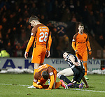 Lewis Morgan celebrates his second goal as Dundee Utd defenders are dejected