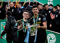 1st March 2020; Wembley Stadium, London, England; Carabao Cup Final, League Cup, Aston Villa versus Manchester City; Phil Foden of Manchester City with the The Alan Hardskar Man of the Match Carabao Cup Final Season 2019/2020 trophy poses alongside Rodrigo of Manchester City with the EFL Cup Trophy