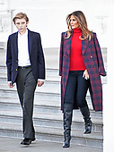 First lady Melania Trump and son Barron walk to accept the White House Christmas tree on the North Portico of the White House in Washington, DC on Monday, November 20, 2017.  The tree will stand in the Blue Room.<br /> Credit: Ron Sachs / CNP