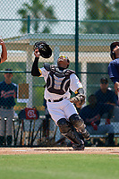 GCL Pirates catcher Gabriel Brito (15) tracks a pop up during a game against the GCL Braves on July 26, 2017 at Pirate City in Bradenton, Florida.  GCL Braves defeated the GCL Pirates 12-5.  (Mike Janes/Four Seam Images)