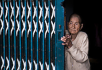 This beautiful old lady just open the gate for me. Near Can Tho, the hub of the Mekong Delta (Vietnamese: Đồng bằng S&ocirc;ng Cửu Long &quot;Nine Dragon river delta&quot;), also known as the Western Region (Vietnamese: Miền T&acirc;y or the South-western region (Vietnamese: T&acirc;y Nam Bộ) is the region in southwestern Vietnam where the Mekong River approaches and empties into the sea through a network of distributaries. The Mekong delta region encompasses a large portion of southwestern Vietnam of 39,000 square kilometres (15,000 sq mi). The size of the area covered by water depends on the season.<br />