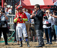 Jockey Mike Smith awaits the outcome of the inquiry as Abel Tasman (no. 1) wins the Personal Ensign Stakes (Grade 1), Aug. 25, 2018 at the Saratoga Race Course, Saratoga Springs, NY.  Ridden by  Mike Smith, and trained by Bob Baffert, Abel Tasman survived an objection and finished 1 3/4 lengths in front of Elate (No. 6).  (Bruce Dudek/Eclipse Sportswire)
