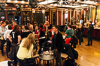 US Fans mingle during half time during a watch party as the USWNT plays Germany during the centennial celebration of U. S. Soccer at Nevada Smiths in New York, NY, on April 05, 2013.