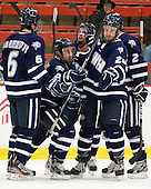 Trevor van Riemsdyk (UNH - 6), John Henrion (UNH - 16), Grayson Downing (UNH - 28), Greg Burke (UNH - 26), Connor Hardowa (UNH - 2) - The Harvard University Crimson defeated the University of New Hampshire Wildcats 7-6 on Tuesday, November 22, 2011, at Bright Hockey Center in Cambridge, Massachusetts.