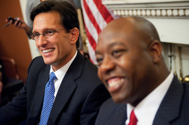 UNITED STATES - SEPTEMBER 12:  House Minority Leader Eric Cantor, R-Va, left, and Rep. Tim Scott, R-S.C., conduct a pen and pad briefing in the Capitol on President Obama's proposed jobs bill and other issues.. (Photo By Tom Williams/Roll Call)