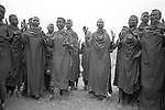 Turkana women performing a traditional dance in a village nr. Lokitaung. <br /> Northern Kenya (borders with Sudan and Ethiopia.).