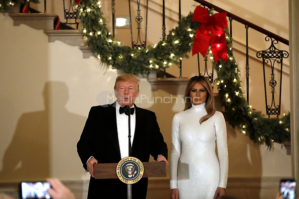 United States President Donald J. Trump makes remarks as First lady Melania Trump looks on at the Congressional Ball at White House in Washington, DC on December 15, 2018. <br /> Credit: Yuri Gripas / Pool via CNP / MediaPunch
