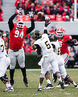 The Georgia Bulldogs beat the App State Mountaineers 45-6 in their homecoming game.  After a close first half, UGA scored 31 unanswered points in the second half.  Appalachian State Mountaineers quarterback Kameron Bryant (5), Georgia Bulldogs defensive end John Taylor (94)