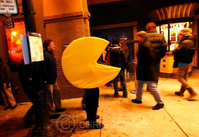 Park City, UT--1/21/07--8:33:25 PM--.Pac-Man strolls outside of the Egyptian Theater....*****************.Sundance '07: Sunday.. Chris Detrick/Salt Lake Tribune.File #_1CD6013....`