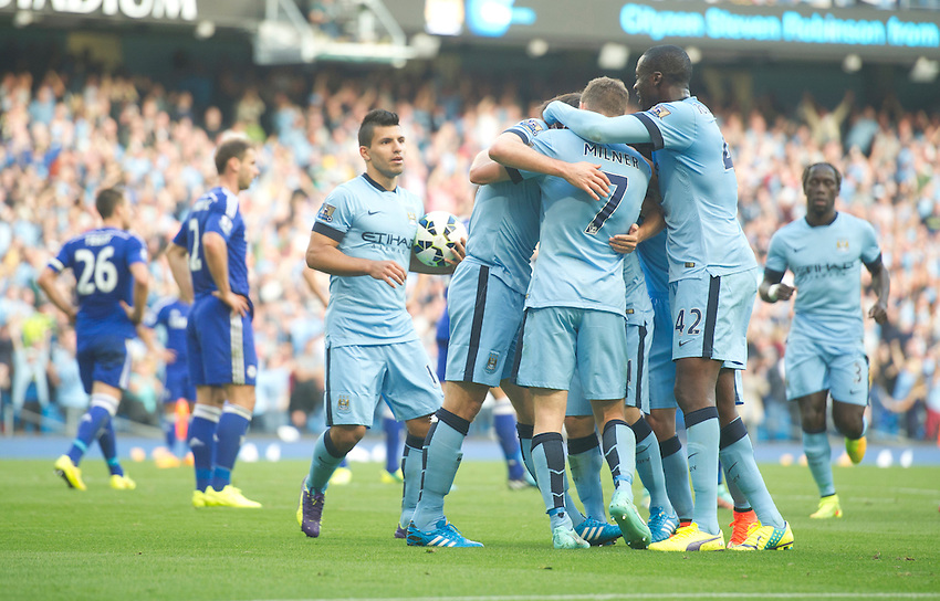 Manchester City's Frank Lampard is congratulated by team-mates James Milner (#7) and Yaya Toure<br /> <br /> Photographer Stephen White/CameraSport<br /> <br /> Football - Barclays Premiership - Manchester City v Chelsea - Sunday 21st September 2014 - Etihad Stadium - Manchester<br /> <br /> &copy; CameraSport - 43 Linden Ave. Countesthorpe. Leicester. England. LE8 5PG - Tel: +44 (0) 116 277 4147 - admin@camerasport.com - www.camerasport.com
