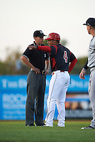 Batavia Muckdogs manager Angel Espada (4) argues a call with umpire Matt Baldwin during a game against the Staten Island Yankees on August 26, 2016 at Dwyer Stadium in Batavia, New York.  Staten Island defeated Batavia 6-2. (Mike Janes/Four Seam Images)