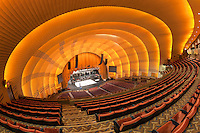 The view of the stage from the balcony as workers prepare for a show in historic Radio City Music Hall in New York City