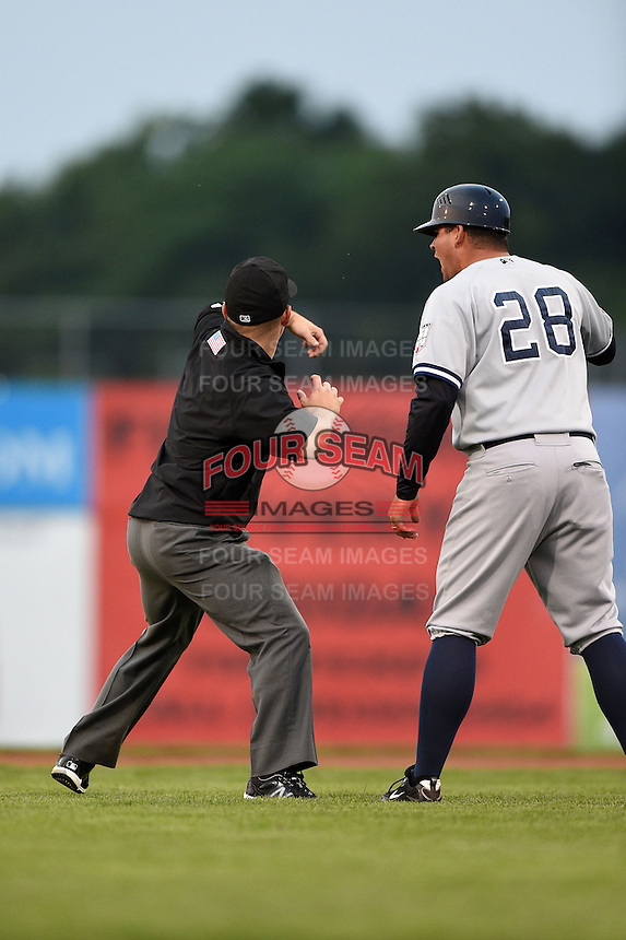 Staten Island Yankees manager Mario Garza (28) argues a call with field umpire Chris Scott  as he gets thrown out of the game during a game against the Batavia Muckdogs on August 7, 2014 at Dwyer Stadium in Batavia, New York.  Staten Island defeated Batavia 2-1.  (Mike Janes/Four Seam Images)