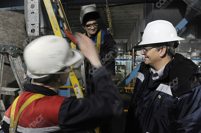 At the Kupol gold mine in Chukotka operated by the Canadian company Kinross, Claude Schimper, the general manager, talked with welders as he toured the mine's mill. Russian Far East, February 7, 2011