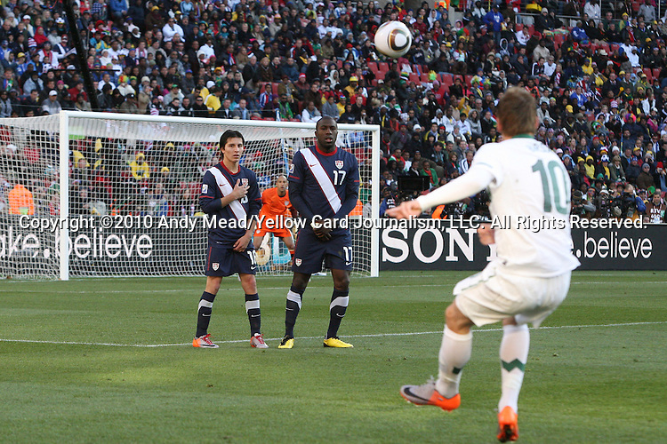 18 JUN 2010: Valter Birsa (SVN) (10) takes a free kick as Jose Torres (USA) (16) and Jozy Altidore (USA) (17) form a defensive wall. The Slovenia National Team tied the United States National Team 2-2 at Ellis Park Stadium in Johannesburg, South Africa in a 2010 FIFA World Cup Group C match.