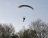 Parachutist about to land having jumped from a hot air balloon.