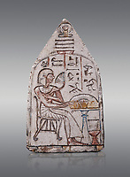 """Ancient Egyptian Ra stele , limestone, New Kingdom, 19th Dynasty, (1279-1190 BC), Deir el-Medina,  Egyptian Museum, Turin. Grey background.<br /> <br /> Akh iqer en Ra """" the excellent spirit of Ra' stele. The individual is smelling a lotus flower. One of three stele forund in different rooms of houses in Deir el-Medina where they stood in niches."""