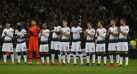 Spurs players take part in a minutes applause for former England goalkeeper Gordon Banks before Tottenham Hotspur vs Borussia Dortmund, UEFA Champions League Football at Wembley Stadium on 13th February 2019