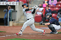 Wisconsin Timber Rattlers catcher Mario Feliciano (4) swings during a game against the Cedar Rapids Kernels at Veterans Memorial Stadium on April 13, 2017 in Cedar Rapids, Iowa.  The Kernels won 2-1.  (Dennis Hubbard/Four Seam Images)