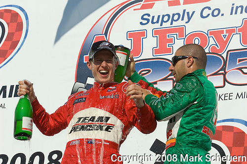 01 June 2008: Third-place finisher Tony Kanaan (BRA), right, treats winner Ryan Briscoe (AUS) to some Champagne after the ABC Supply Company Inc. AJ Foyt 225 IndyCar race at the Milwaukee Mile, West Allis, Wisconsin.