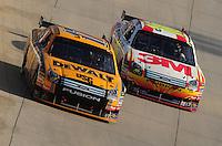 Sept. 21, 2008; Dover, DE, USA; Nascar Sprint Cup Series driver Greg Biffle (16) races alongside teammate Matt Kenseth (17) for the lead during the Camping World RV 400 at Dover International Speedway. Mandatory Credit: Mark J. Rebilas-