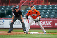 Bowie Baysox first baseman Joey Terdoslavich (7) in position with umpire Mike Provine looking on during a game against the Erie SeaWolves on May 12, 2016 at Jerry Uht Park in Erie, Pennsylvania.  Bowie defeated Erie 6-5.  (Mike Janes/Four Seam Images)