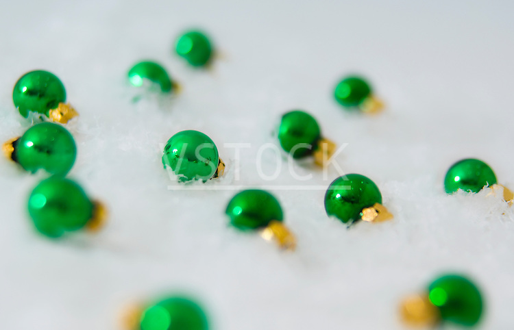 horizontal mini miniature Christmas ornament ornaments snow still life pattern background Christmas xmas holiday season seasonal decor decoration decorative ornamental green bulb ball festive festivity festivities celebrating celebration custom tradition traditional snowy winter wintertime cold frigid freezing chilly