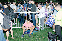 """People wait for the arrival of entrepreneur and Democratic presidential candidate Andrew Yang before a campaign rally in Cambridge Common near Harvard Square in Cambridge, Massachusetts, on Mon., September 16, 2019. Yang's unlikely presidential bid is centered on his idea for a """"Freedom dividend,"""" which would give USD$1000 per month to every adult in the United States. After appearing in three Democratic party debates, Yang has risen in polls from longshot candidate to within the top 10."""