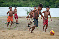 Wounan indian kids play soccer in a small village of Choco department, in the Pacific Coast of Colombia.